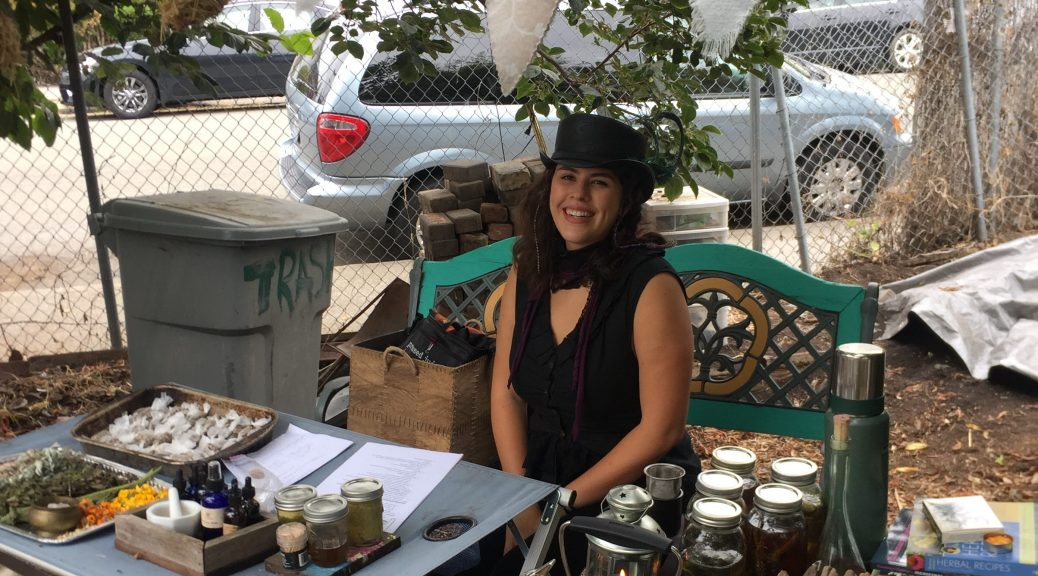 Camilla Leal preparing for  the How to Use Medicinal Herbs workshop 7/31/16.